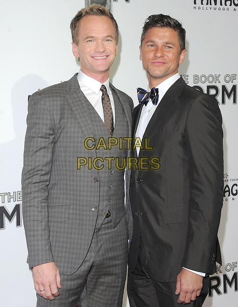 "Neil Patrick Harris & David Burtka.""The Book of Mormon"" Hollywood Opening night Held At The Pantages theatre, Hollywood, California, USA..September 12th, 2012.half length grey gray black waistcoat suit tuxedo couple check .CAP/DVS.©DVS/Capital Pictures."