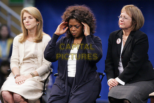 CAROLINE KENNEDY & OPRAH WINFREY.At The GOTV Rally held at UCLA's Pauley Paviliion in Westwood, California, USA, February 03 2008..half length hands on head sitting.CAP/DVS.?Debbie VanStory/Capital Pictures