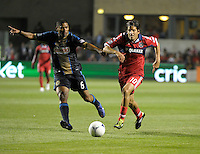 Chicago Fire midfielder Sebastian Grazzini (10) dribbles away from Philadelphia Union midfielder Gabriel Gomez.  The Chicago Fire defeated the Philadelphia Union 1-0 at Toyota Park in Bridgeview, IL on March 24, 2012.