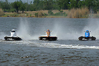 Frame 1: Rob Rinker, (#10), Mark Schmerbach, (#35) and Jeremy Hebert, (#51) race 3-wide into turn 4 where Schmerbach and Hebert make contact with Schmerbach spinning into the path of Rinker who rides up and over the #35 boat and flips upside down.