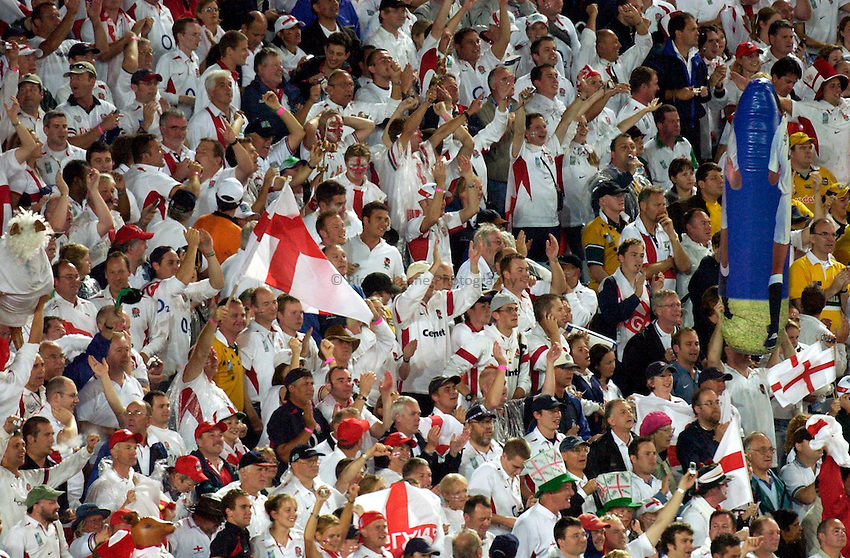 Photo: Steve Holland..Australia v England. Rugby World Cup Final, at the Telstra Stadium, Sydney. RWC 2003. 22/11/2003. .England supporters celebrate their sides victory.