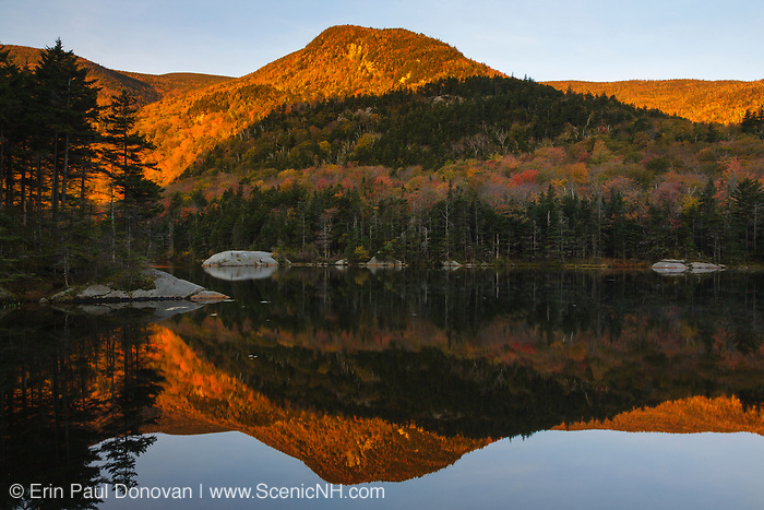 Kinsman Notch - Reflection of mountains in Beaver Pond on the side of Route 112 in North Woodstock, New Hampshire, part of the White Mountains, during the autumn months.