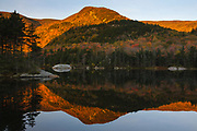 Kinsman Notch - Reflection of mountains in Beaver Pond in the White Mountains, New Hampshire USA during the autumn months