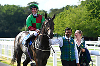 Winner of The Toby Balding Memorial Novice Stakes (Plus 10), Nyaleti ridden by John Egan and trained by Mark Johnston are led into the winners enclosure during Father's Day Racing at Salisbury Racecourse on 18th June 2017