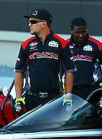 Sep 13, 2013; Charlotte, NC, USA; Crew members for NHRA top fuel dragster driver Billy Torrence during qualifying for the Carolina Nationals at zMax Dragway. Mandatory Credit: Mark J. Rebilas-