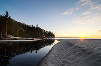 The sun setting over Lake Superior at the mouth of the Miners River and Miners Beach. Pictured Rocks National Lakeshore - Munising, MI