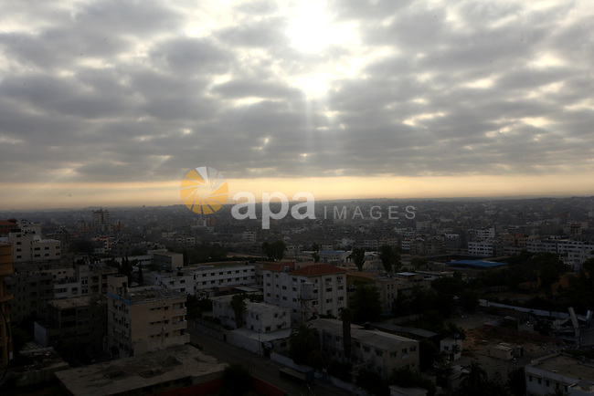 A general view shows the Gaza city during the sunrise, on August 11, 2014. Palestinian and Israeli negotiators on Sunday said they had accepted an Egyptian proposal for a new 72-hour truce with Israel, clearing the way for a possible resumption of talks on a long-term cease-fire arrangement in the Gaza Strip. Photo by Mohammed Othman