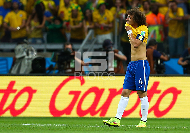 David Luiz of Brazil shows a look of dejection