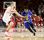 VERMILLION, SD - JANUARY 24: Brandon Key #0 from South Dakota State University drives against Nick Fuller #34 from the University of South Dakota during their game Wednesday night at the Sanford Coyote Sports Center in Vermillion, SD. (Photo by Dave Eggen/Inertia)