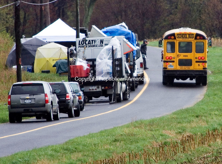 WOODBURY, CT- 29 APRIL 2008- 042908JT04-<br /> Children riding home from school crowd the windows as they pass by film crews working on &quot;Fairlanders,&quot; a movie starring John Krasinski and Maya Rudolph, on Upper Grassy Hill Road near Route 317 in Woodbury on Tuesday.<br /> Josalee Thrift / Republican-American