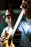 JAMAICA, Port Antonio. Albert Minott of the Mento band, The Jolly Boys playing guitar at the Willow Wind Bar.