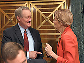 """United States Senator Mike Crapo, Chairman, US Senate Committee on Banking, Housing, and Urban Affairs, left, shares conversation with US Senator Elizabeth Warren (Democrat of Massachusetts) , right, prior to hearing testimony from Timothy J. Sloan, Chief Executive Officer and President, Wells Fargo & Company, at a hearing entitled, """"Wells Fargo: One Year Later"""" on Capitol Hill in Washington, DC on Tuesday, October 3, 2017. <br /> Credit: Ron Sachs / CNP"""