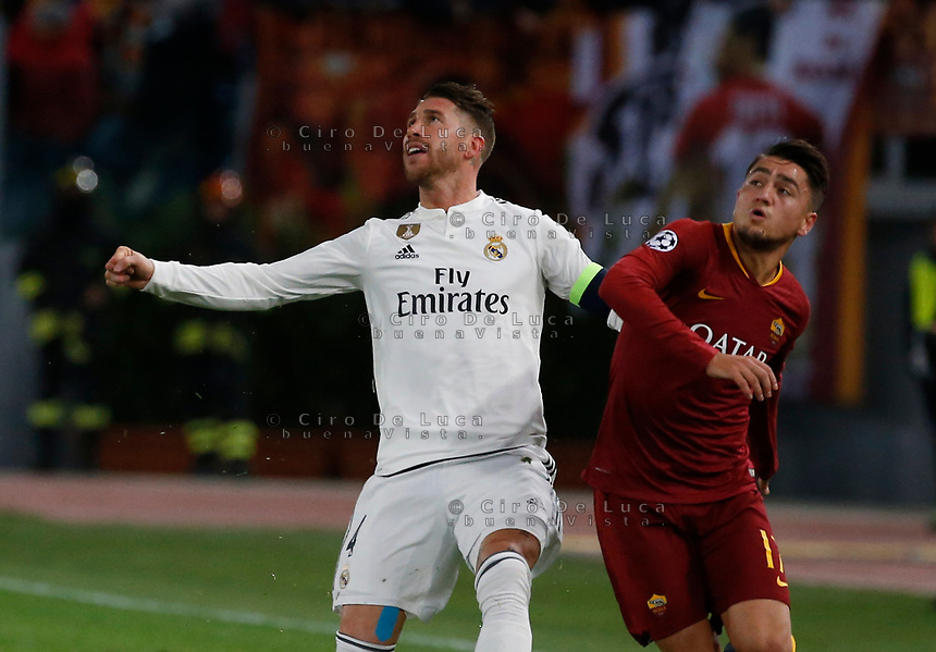 Sergio Ramos of Real Madrid and Cenzig Under of AS Roma  during the Champions League Group  soccer match between AS Roma - Real Madrid  at the Stadio Olimpico in Rome Italy 27 November 2018