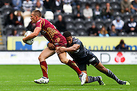 PICTURE BY ALEX WHITEHEAD/SWPIX.COM - Rugby League - Super League - Hull FC v Huddersfield Giants - KC Stadium, Hull, England - 01/07/12 - Huddersfield's Greg Eden is tackled by Hull's Jordan Turner.