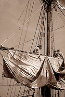 Sailors dressed in historical costume,  aloft in rigging preparing to set sail on the brigantine Lady Washington, Tall Ships Festival 2002, Steveston BC