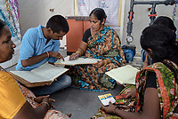 Members of the self help group gather for a meeting at the iJal station in Ambedkar Nagar in Medak, Telangana, India.