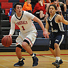 Kyle Acquavella #1 of MacArthur, left, feels defensive pressure from Monami Degas #5 of Hjemly (Ringe, Denmark) during a game in the Jeff Shaw Memorial Basketball Tournament at MacArthur High School on Thursday, Dec. 1, 2016. Acquavella scored a game-high 17 points in MacArthur's 65-43 win.