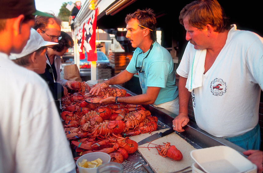 Tourists pick their own lobster to eat at famous Woodman's restaurant. Essex, Massachusetts.