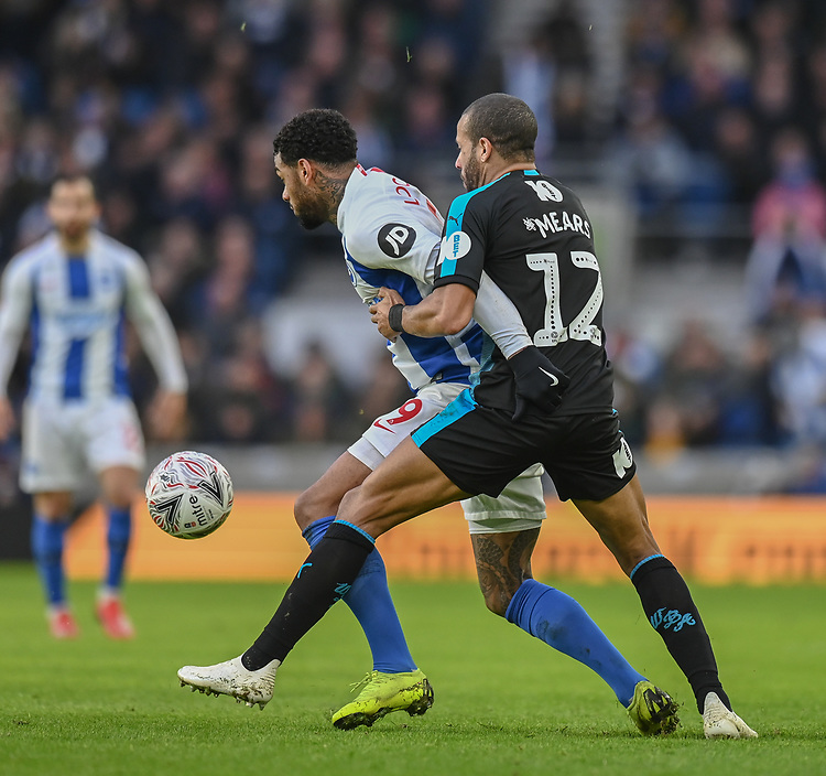 Brighton & Hove Albion's Jurgen Locadia (left) is tackled by  West Bromwich Albion's Tyrone Mears (right) <br /> <br /> Photographer David Horton/CameraSport<br /> <br /> Emirates FA Cup Fourth Round - Brighton and Hove Albion v West Bromwich Albion - Saturday 26th January 2019 - The Amex Stadium - Brighton<br />  <br /> World Copyright © 2019 CameraSport. All rights reserved. 43 Linden Ave. Countesthorpe. Leicester. England. LE8 5PG - Tel: +44 (0) 116 277 4147 - admin@camerasport.com - www.camerasport.com