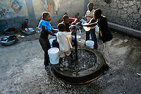 Haitians fill plastic barrels with safe drinking water from a public water pump in Port-au-Prince, Haiti, 9 July 2008. Although Latin America (as a whole) is blessed with an abundance of fresh water, having 20% of global water resources in the the Amazon Basin and the highest annual rainfall of any region in the world, an estimated 50-70 million Latin Americans (one-tenth of the continent's population) lack access to safe water and 100 million people have no access to any safe sanitation. Complicated geographical conditions (mainly on the Pacific coast), unregulated industrialization (causing environmental pollution) and massive urban poverty, combined with deep social inequality, have caused a severe water supply shortage in many Latin American regions.