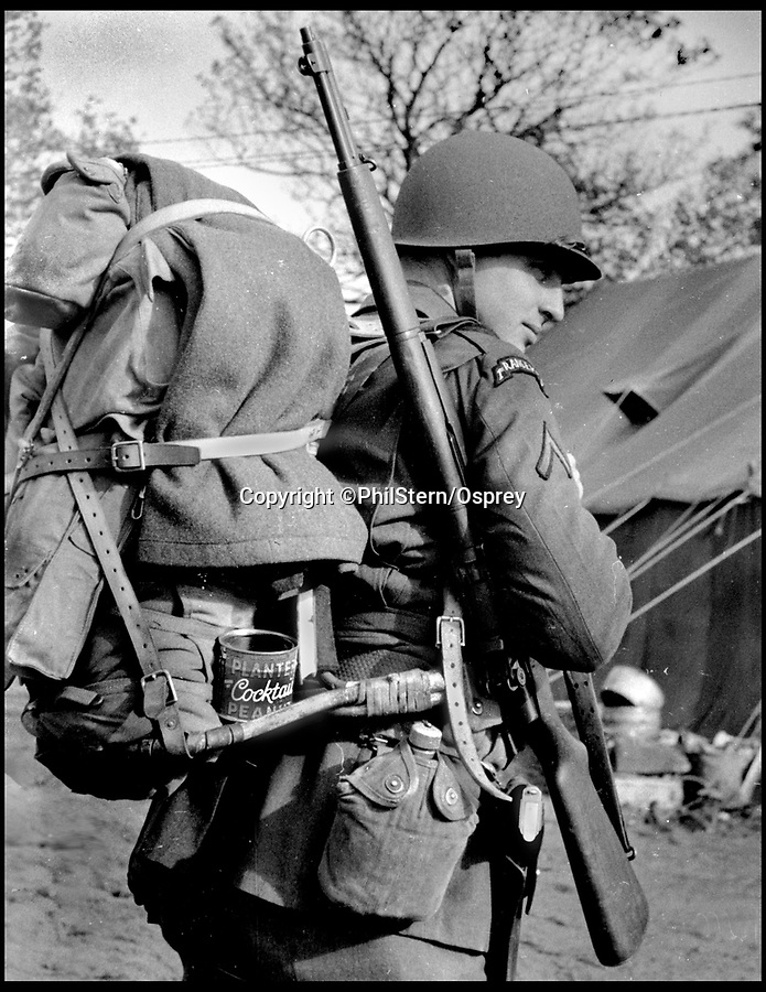 BNPS.co.uk (01202 558833)<br /> Pic: PhilStern/Osprey/BNPS<br /> <br /> Fully loaded Ranger in Achnacarry, Scotland, in 1942.<br /> <br /> New book on photographer Phil Stern reveals the formation of US special forces in Scotland during WW2.<br /> <br /> These fascinating photos reveal how American troops were put through their paces by British commandos in the Scottish Highlands during the Second World War.<br /> <br /> American President Franklin D Roosevelt feared his troops lacked combat experience as they entered the global conflict in the aftermath of Pearl Harbor.<br /> <br /> This being the case, he established a 'hit and run' group to be trained by battle-hardened British commandos who had launched successful raids against the German held Lofoten Islands in Norway.<br /> <br /> Five hundred men were recruited to be part of the 1st Ranger Battalion who began exercises at the British Commando Training Depot in Achnacarry, North Scotland, on June 28, 1942.