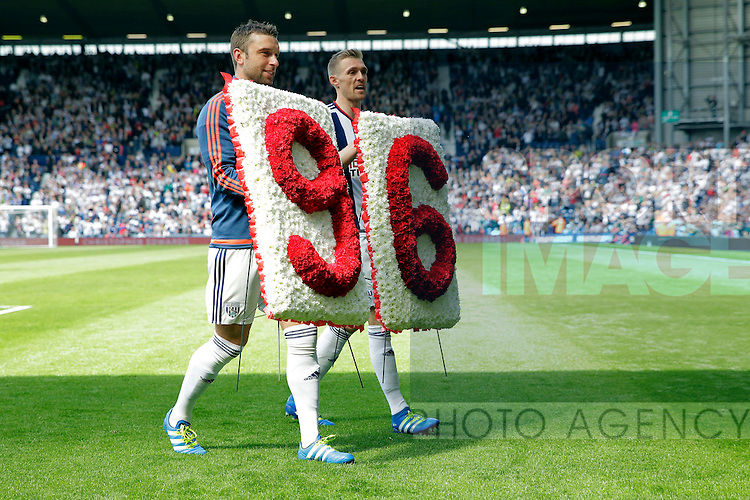 Ricky Lambert and Darren Fletcher bring a floral tribute to Liverpool supporters before the Barclays Premier League match at The Hawthorns.  Photo credit should read: Malcolm Couzens/Sportimage