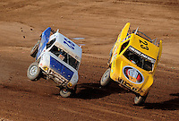 Apr 17, 2010; Surprise, AZ USA; LOORRS pro light unlimited driver Jerry Daugherty (23) and Jacob Person (92) collide over a jump during round 3 at Speedworld Off Road Park. Mandatory Credit: Mark J. Rebilas-US PRESSWIRE.