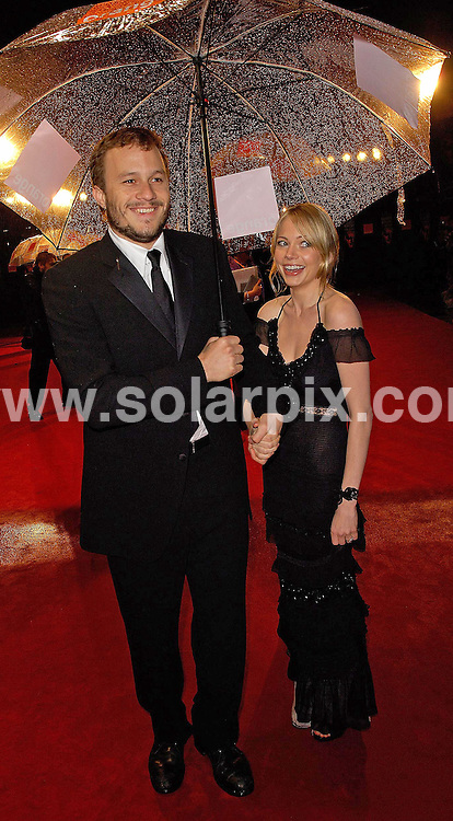 **ALL ROUND PICTURES FROM SOLARPIX.COM**.International stars from the worlds of tv and film braved the bad weather to attend the 2006 BAFTA Awards in London's Leicester Square yesterday evening 19.02.06.  Ang Lee's Brokeback Mountain scooped 4 awards including Best Film..This pic: Heath Ledger and Michelle Williams..JOB REF: 2147 MSR                      Date:19_02_2006