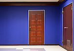 Apartment wooden door and blue wall background texture