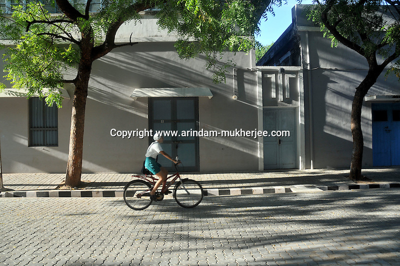 A bycycle rider in front of Arobindo Ashram building in Pondicherry.Arindam Mukherjee/Sipa