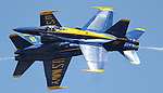 Two Blue Angels F-18's tear past each other in a flight demonstration over Annapolis.