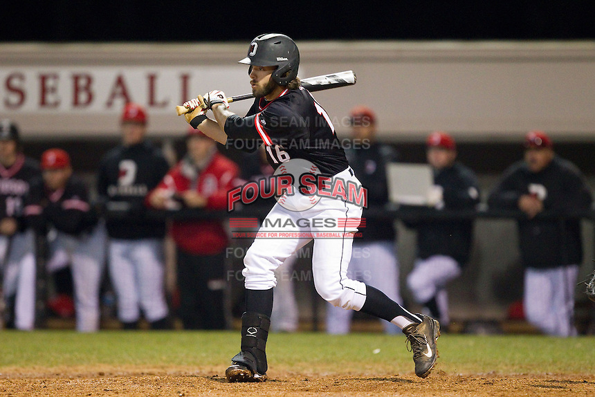 Lee Miller (16) of the Davidson Wildcats follows through on his swing against the Wake Forest Demon Deacons at Wilson Field on March 19, 2014 in Davidson, North Carolina.  The Wildcats defeated the Demon Deacons 7-6.  (Brian Westerholt/Four Seam Images)