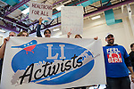 "Westbury, New York, USA. January 15, 2017.  LI Activists group members bring a large banner and signs, and one wears ""FEEL THE BERN"" T-shirt to the ""Our First Stand"" Rally against Republicans repealing the Affordable Care Act, ACA, taking millions of people off health insurance, making massive cuts to Medicaid, and defunding Planned Parenthood. Hosts were Reps. K. Rice (Democrat - 4th Congressional District) and T. Suozzi (Dem. - 3rd Congress. Dist.). It was one of dozens of nationwide Bernie Sanders' rallies for health care that Sunday."