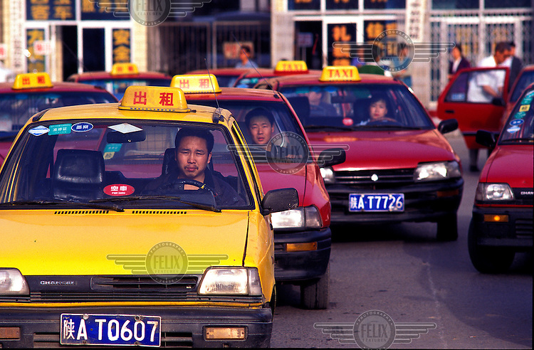 ©Chris Stowers/Panos Pictures..Queues of taxies waitng for a fare in the central Chinese city of Xian.