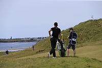Thomas Detry (BEL) and caddy Ryan wait to play his 2nd shot on the 6th hole during Thursday's Round 1 of the Dubai Duty Free Irish Open 2019, held at Lahinch Golf Club, Lahinch, Ireland. 4th July 2019.<br /> Picture: Eoin Clarke | Golffile<br /> <br /> <br /> All photos usage must carry mandatory copyright credit (© Golffile | Eoin Clarke)