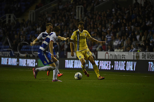 16.09.2014.  Reading, England. Sky Bet Championship. Reading versus Millwall. Upson takes the ball around 2 defenders