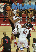 NWA Media/Michael Woods --11/21/2014-- w @NWAMICHAELW...University of Arkansas forward Michael Qualls drives to the hoop to score during the first half of Friday nights game  against Delaware State at Bud Walton Arena in Fayetteville.