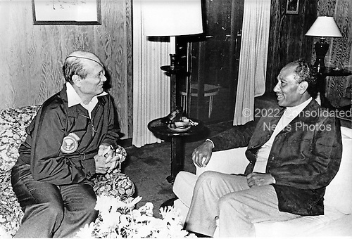 Foreign Minister Moshe Dayan, left, meets President Anwar Sadat of Egypt, right, at Dogwood Lodge at Camp David, near Thurmont, Maryland  on Thursday, September 14, 1978..Credit: White House via CNP