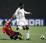 15 July 2007: Chile's Dagoberto Currimilla (8) challenges Nigeria's Efe Ambrose (6). Chile's Under-20 Men's National Team defeated Nigeria's Under-20 Men's National Team 4-0 after extra time in a  quarterfinal match at Olympic Stadium in Montreal, Quebec, Canada during the FIFA U-20 World Cup Canada 2007 tournament.