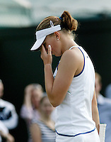 28-6-06,England, London, Wimbledon, first round match,  Michaella Krajicek facing defeat