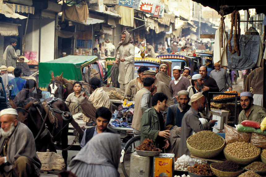 Busy city street, market in Peshawar, Pakistan. street scene, commercial district, bazaar, trade, crowd. Peshawar street sceens. Peshawar, Pakistan Asia.