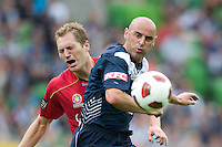 MELBOURNE, AUSTRALIA - JANUARY 09: Kevin Muscat of the Victory fouls Adam Hughes of United and is given a second yellow card during the round 22 A-League match between the Melbourne Victory and Adelaide United at AAMI Park on January 9, 2011 in Melbourne, Australia. (Photo by Sydney Low / Asterisk Images)