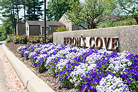 Housing development entrance sign in full spring bloom. Your real estate photos should create a homey, welcoming impression, and sometimes a feature like this entrance sign completes the look. By Art Harman.