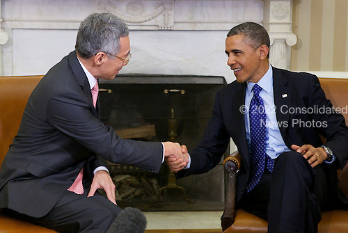 United States President Barack Obama meets with Prime Minister Lee Hsien Loong of Singapore in the Oval Office of the White House in Washington, D.C. on Tuesday, April 2, 2013..Credit: Molly Riley / Pool via CNP