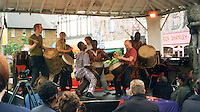 Percussionists playing traditional Ghananian music on djembes and dun duns on the Master Musicians of Ghana Tour, London 2000., London