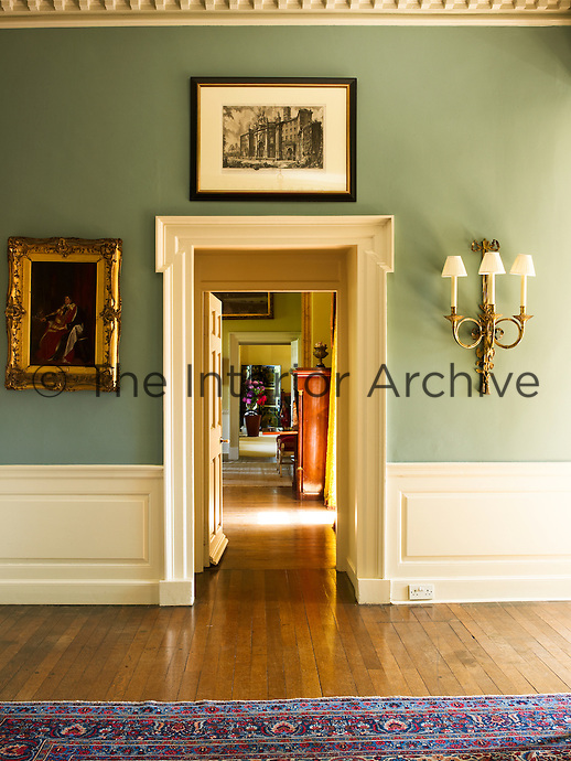 View from the green-painted entrance hall through the enfilade of reception rooms