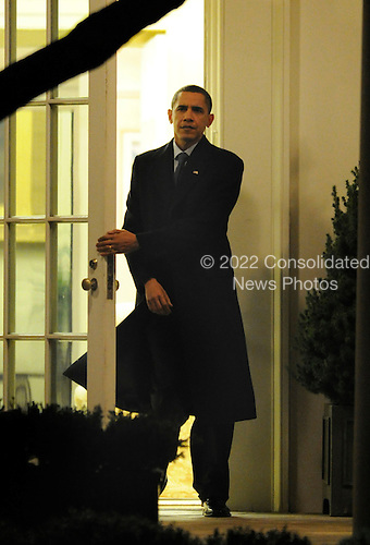 Washington, DC - December 17, 2009 -- United States President Barack Obama walks from the Oval Office as he departs the White House to board Marine One in Washington, DC, USA, which will take him to Air Force One for his trip to Copenhagen, Denmark, Thursday, 17 December 2009.  Obama will be attending the United Nation's international climate conference, which has been going on all week.               .Credit: Mike Theiler / Pool via CNP