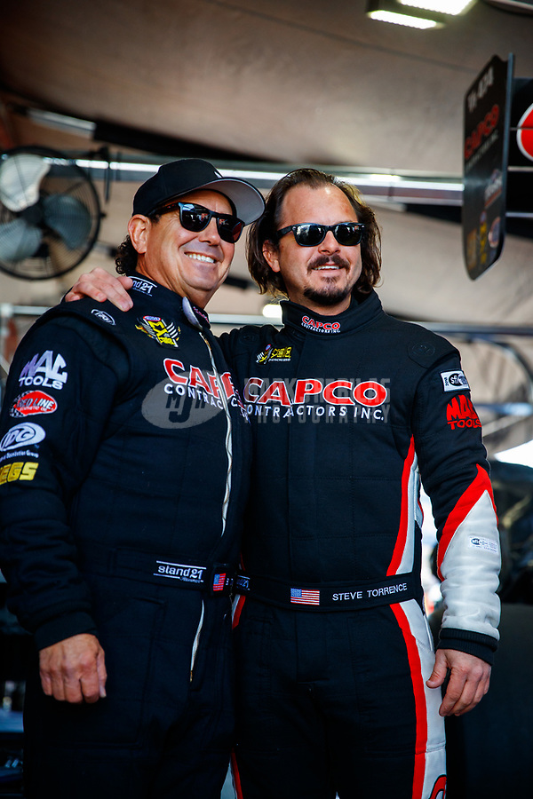 Feb 25, 2018; Chandler, AZ, USA; NHRA top fuel driver Steve Torrence (right) and father Billy Torrence during the Arizona Nationals at Wild Horse Pass Motorsports Park. Mandatory Credit: Mark J. Rebilas-USA TODAY Sports
