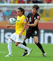 Amy Le Peilbet (r) of team USA and Marta of team Brazil during the FIFA Women's World Cup at the FIFA Stadium in Dresden, Germany on July 10th, 2011.