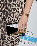 WEST HOLLYWOOD, CA- SEPTEMBER 12: Actress Emily Deschanel (handbag, bracelet, ring detail) at Mercy For Animals 15th Anniversary Gala at The London on September 12, 2014 in West Hollywood, California.